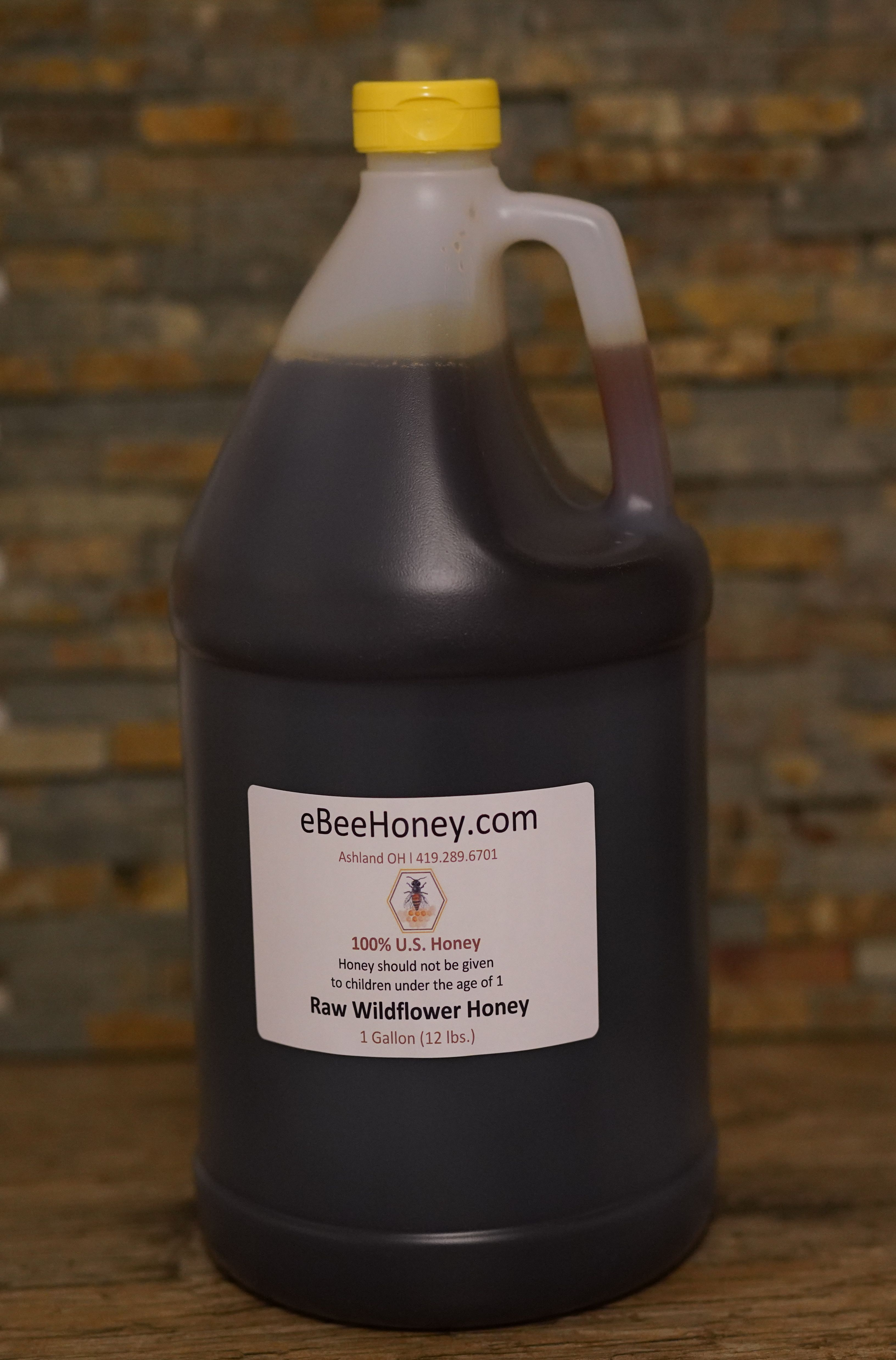 Raw Wildflower Honey in a 1 gallon container. This is 12 ...